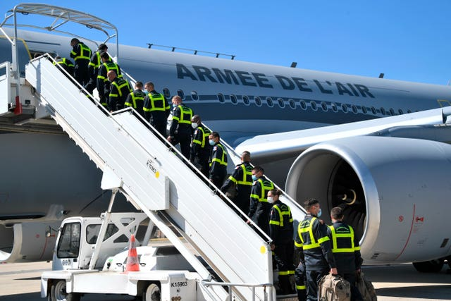 French Securite Civile rescue workers board a military plane bound for Lebanon (Bertrand Guay/Pool/AP)