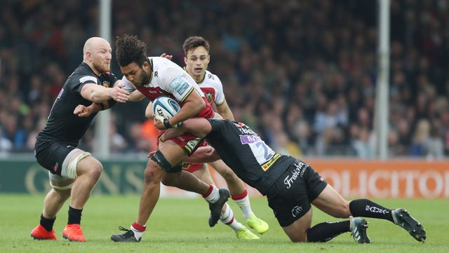 Northampton's Lewis Ludlam is tackled by Exeter's Jack Yeandle
