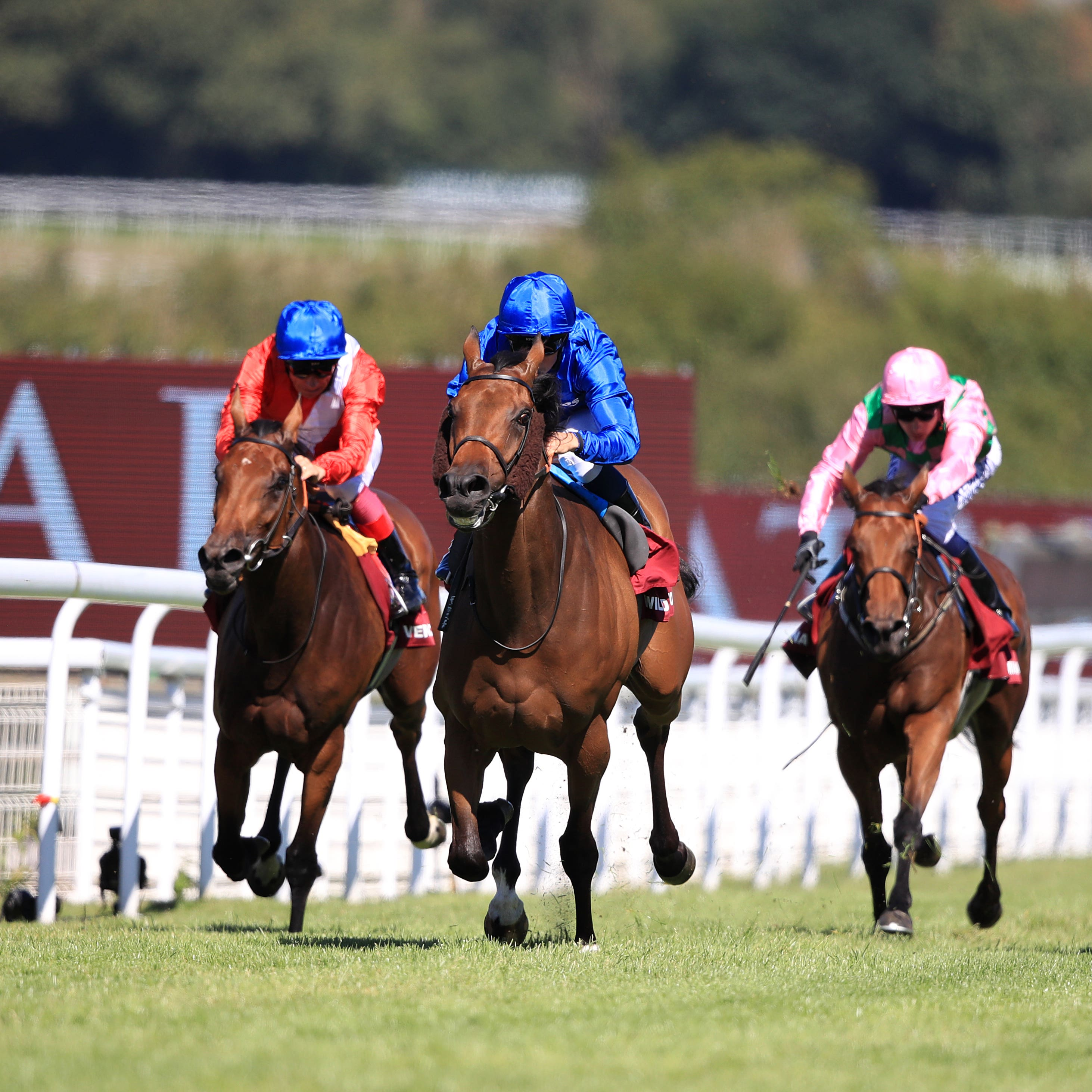 Wild Illusion and William Buick (blue silks) seen winning the Nassau Stakes at Goodwood