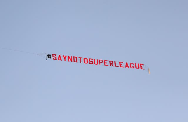 A plane with a 'Say No To Super League' banner flies over Elland Road on Monday