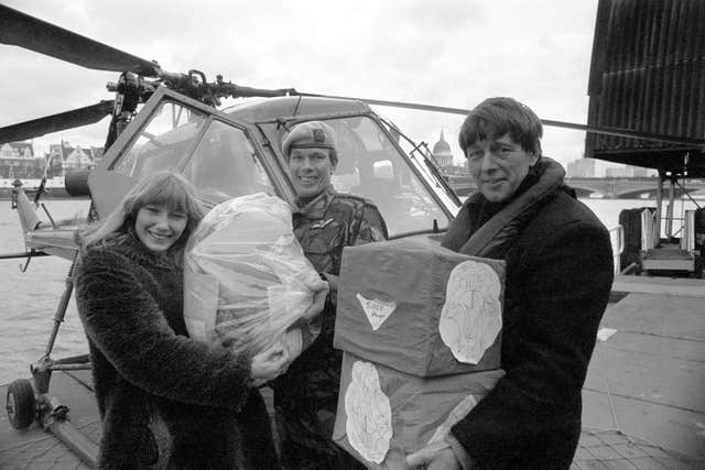 Blue Peter presenters Lesley Judd and John Noakes receive a special delivery from Captain Mike Bell of the Third Regiment, Army Air Corps, Wiltshire, containing 30,000 stamps for Blue Peter's Lifeline Lebanon Appeal. (Image: PA)