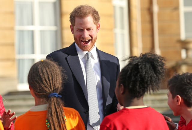 The Duke of Sussex meets children in the Buckingham Palace gardens