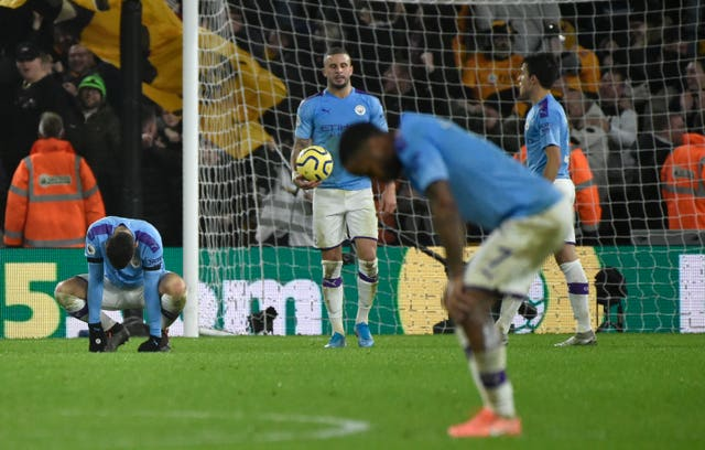 Manchester City players dejected at Wolves