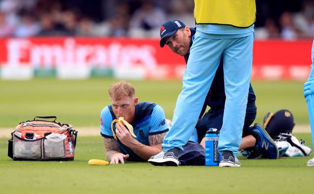 England's Ben Stokes eats a banana whilst receiving treatment from a physio