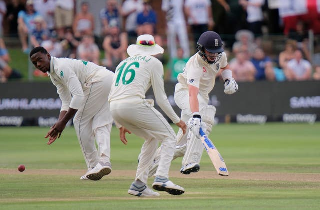 Pope runs a single as South Africa's Kagiso Rabada, left, and Keshav Maharaj field