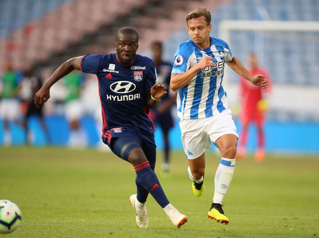 Lyon's Tanguy Ndombele (left) has also been linked with Spurs.