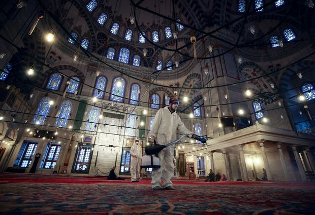 A worker at a mosque in Istanbul