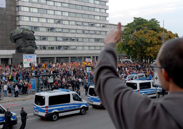 People attend a demonstration in Chemnitz