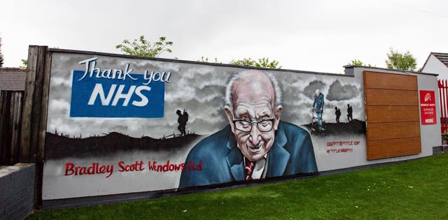 A mural paying tribute to NHS fundraiser Captain Tom Moore outside Bradley Scott Windows in Tamworth, Staffordshire