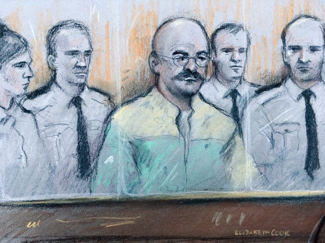 Court artist sketch of Charles Bronson listening as prison governor Mark Docherty gives evidence at Leeds Crown Court
