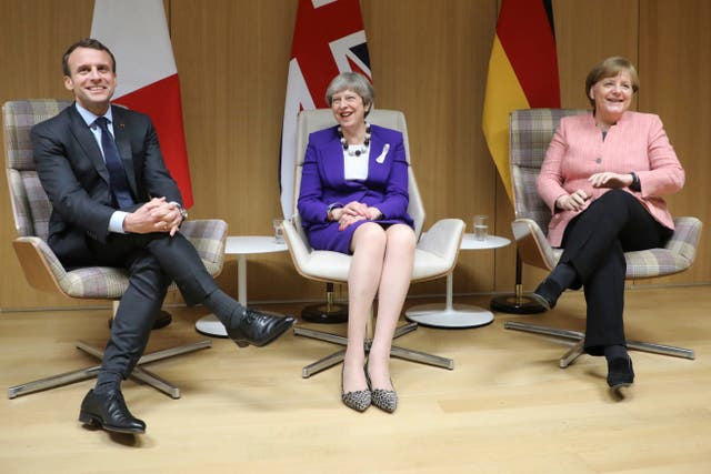 Prime Minister Theresa May with French President Emmanuel Macron and German Chancellor Angela Merkel (Ludovic Marin/AP)