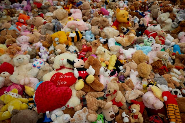 Some of the 2,000 teddy bears left as tributes to children and others killed in the bombing (Manchester City Council/PA)