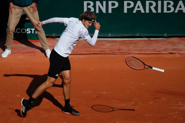 Alexander Zverev throws his racket to the ground during his loss to Jannik Sinner