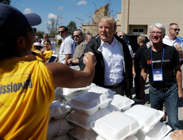 President Donald Trump visits the Temple Baptist Church, where food and other supplies are being distributed during Hurricane Florence recovery efforts