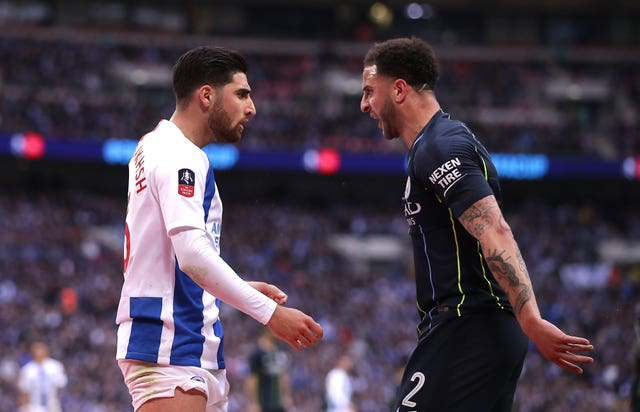 Kyle Walker, right, reacts to Alireza Jahanbakhsh's challeng