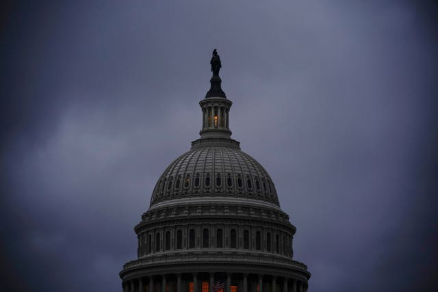 The light in the cupola of the Capitol Dome signals that the Senate is in session overnight as 30 hours of time must elapse before the final vote on the confirmation of Amy Coney Barrett to join the Supreme Court (J. Scott Applewhite/AP)