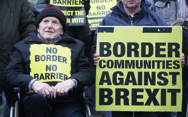 Anti-Brexit placards held by people living near the Irish border