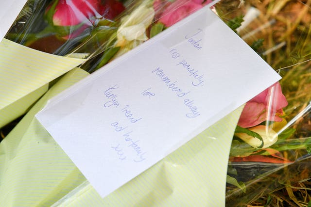 Floral tributes have been left at the scene of the crash (Ben Birchall/PA).