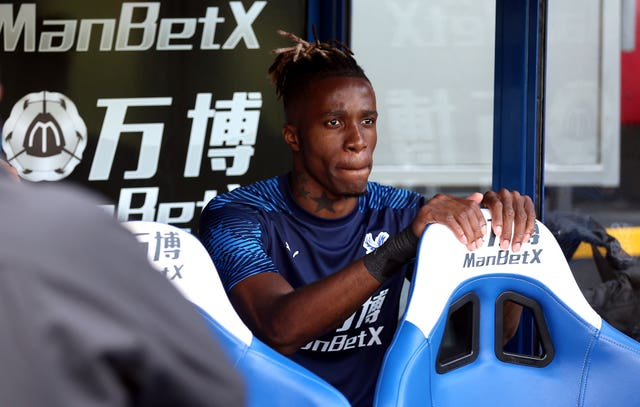 Wilfried Zaha was on the bench for Crystal Palace after a failed deadline-day move to opponents Everton