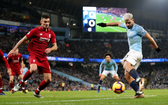 Manchester City's Sergio Aguero, right, scores against Liverpool in January
