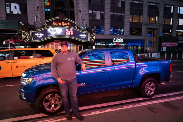 Steve Cruz poses with his Chevy Colorado in New York's Times Square during the coronavirus pandemic