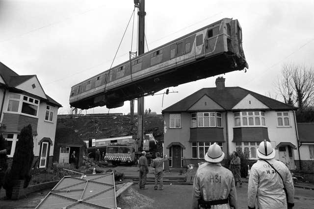 One of the Purley train crash carriages is hoisted by a crane during the clear up operation