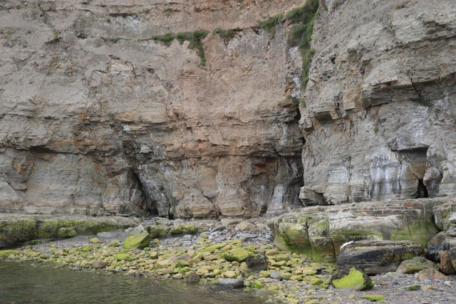 The bottom of the cliff face near the beach at Seaton Garth in Staithes