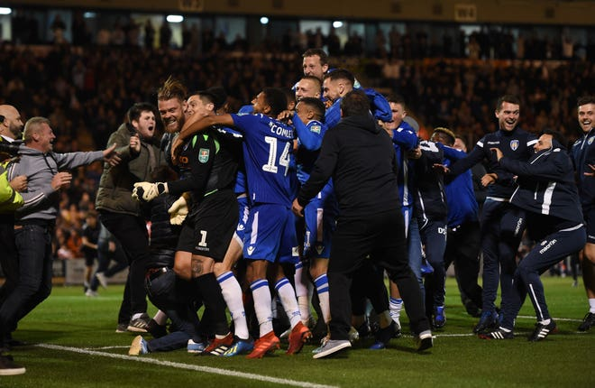Colchester fans invaded the pitch after their side's win against Tottenham