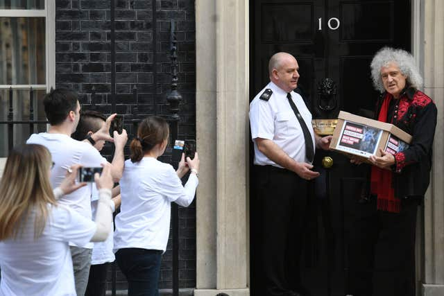May joined animal protection campaigners at No 10 to hand in the 400,000 -strong petition (Stefan Rousseau/PA)
