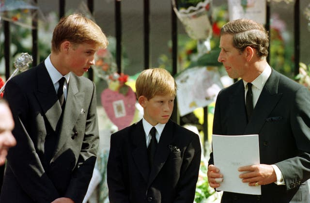 The Prince of Wales, Prince William and Prince Harry wait outside Westminster Abbey for Diana, the Princess of Wales' coffin to enter the Abbey (Adam Butler/PA)