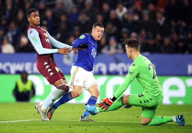 Orjan Nyland saves from Jamie Vardy, centre, in the semi-final first leg