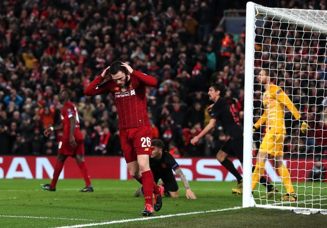 Liverpool's Andrew Robertson reacts after his header hits the crossbar