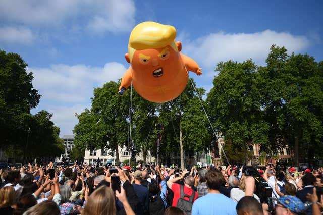A 'Baby Trump' balloon rises after being inflated in London's Parliament Square, as part of the protests against the visit of US President Donald Trump to the UK.