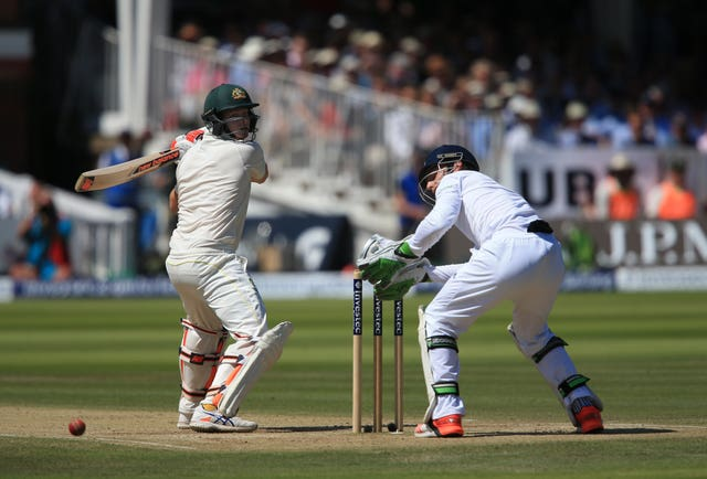 Jos Buttler, right, is beaten by a Steve Smith mis-hit