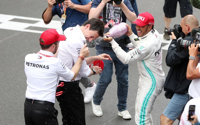 Hamilton celebrates victory with team principal Toto Wolff