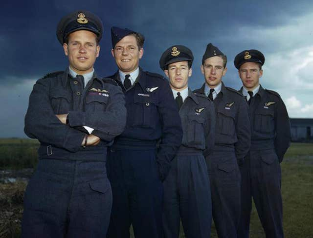 Leader of the Dambusters raid Wing Commander Guy Gibson, with members of his Lancaster crew, (left to right) Pilot Officer PM Spafford, bomb aimer; Flight Lieutenant REG Hutchinson, wireless operator; Pilot Officer GA Deering and Flying Officer HT Taerum, gunner (Imperial War Museum/PA)