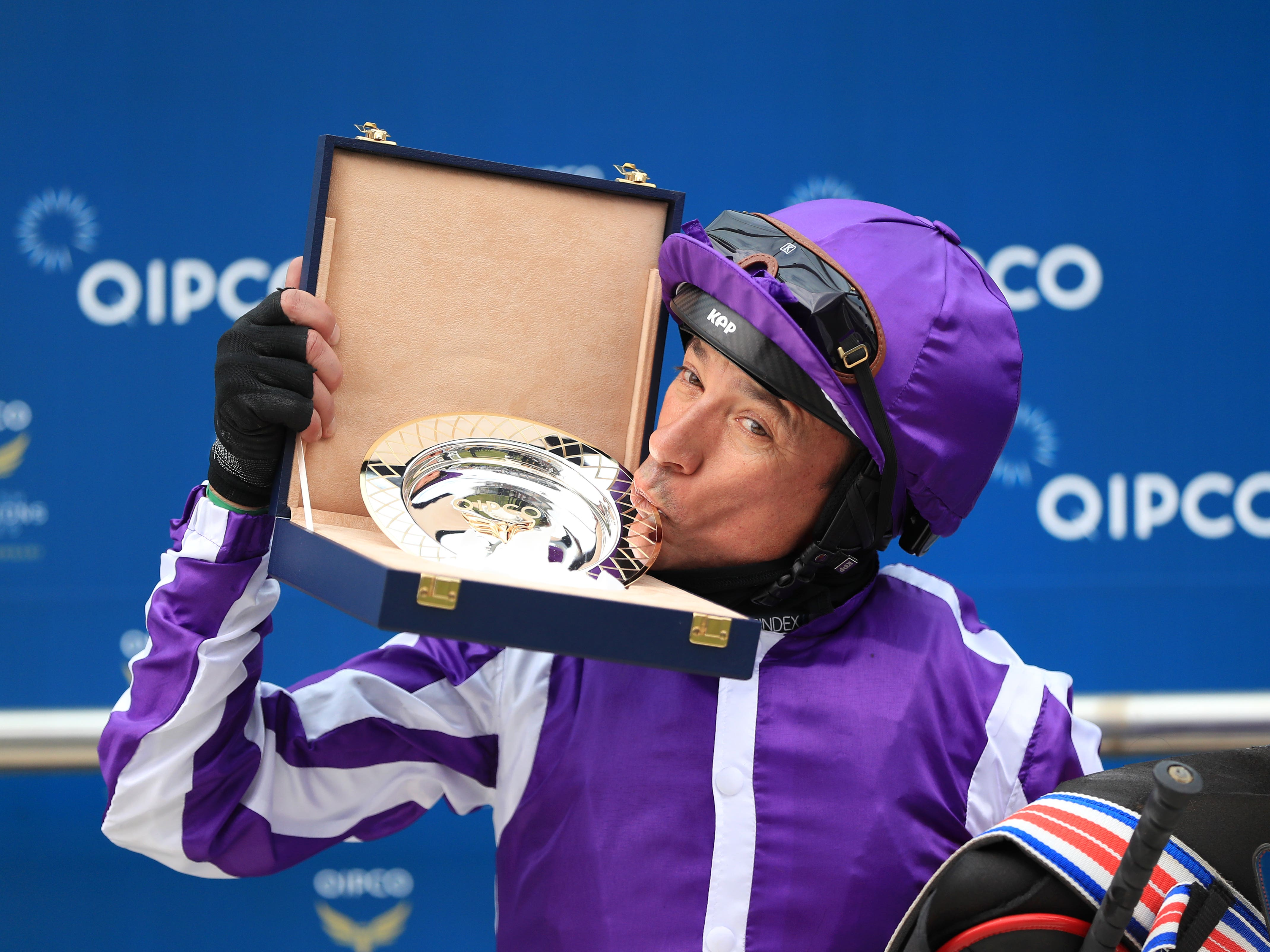 Frankie Dettori kisses the trophy after winning the Qipco 1000 Guineas (Mike Egerton/PA)