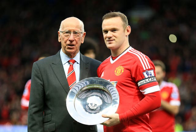Sir Bobby Charlton presents Wayne Rooney with a trophy marking his 500th appearance for Manchester United