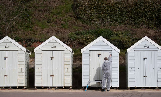 There were quieter scenes on Bournemouth beach on Monday - allowing for a lick of paint on the beach hunts