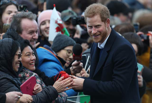 Prince Harry apologised to wellwishers after the couple's train was delayed (Andrew Matthews/PA)