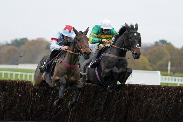 Espoir De Guye and Charlie Deutsch (left) clears the last at Ascot