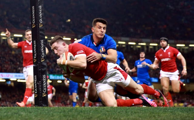 Josh Adams scored a hat-trick of tries for Wales