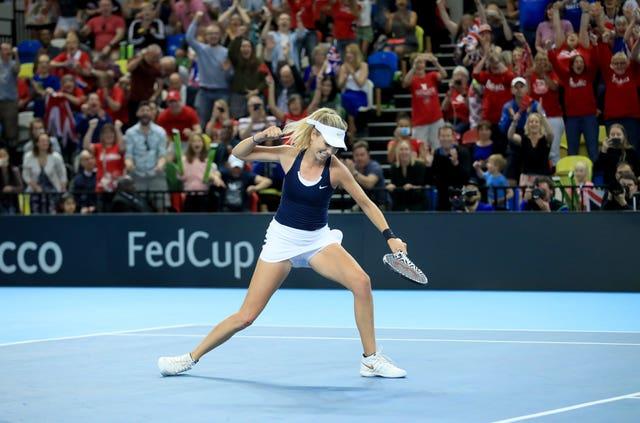 Katie Boulter punches the air after beating Kazakhstan's Zarina Diyas