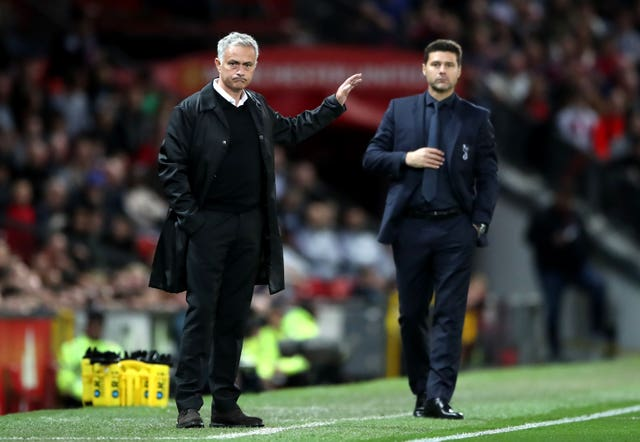 Jose Mourinho, left, reacted angrily to reporters following a loss to Mauricio Pochettino's Tottenham