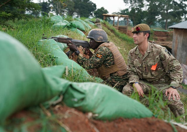 Pierre Ozanne from the British Army helps train a Ugandan soldier in Singo