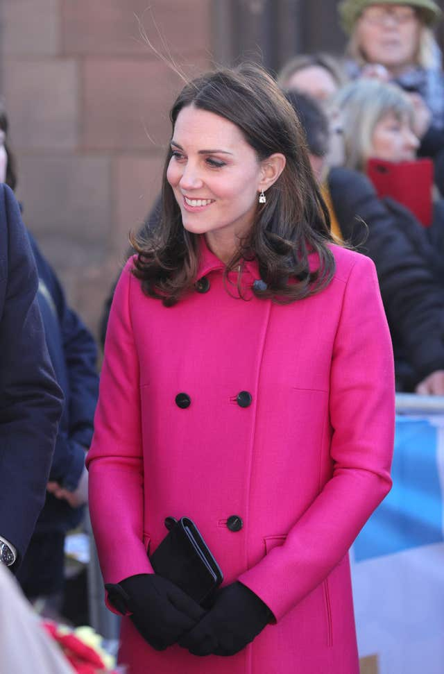 The Duchess looked fantastic, as always, in a striking pink coat (Aaron Chown/PA)