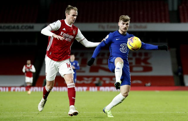 Timo Werner shields the ball from Rob Holding