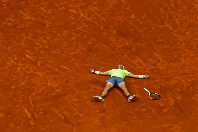 Rafael Nadal lies flat on his back after winning his 12th title