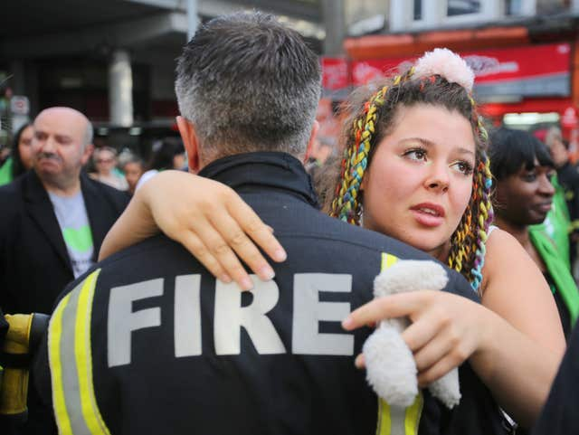 Woman hugs firefighter