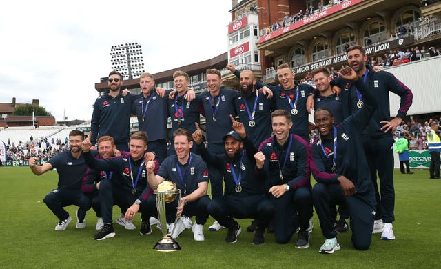 Chris Woakes, Eoin Morgan and the rest of the England team celebrate their World Cup win
